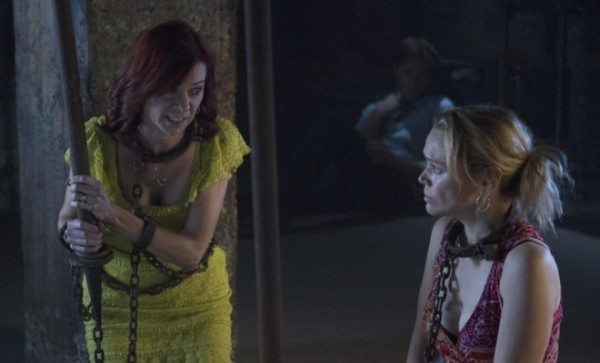 Arelen and Holly chained up in the basement of Fangtasia.