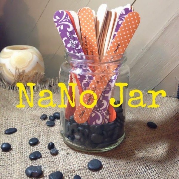 """A picture of a glass jar filled with colorful popsicle sticks, captioned """"Nano Jar"""""""