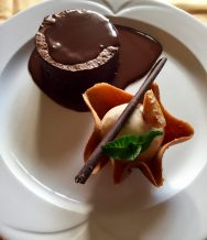 Dark chocolate and mixed nut Brownie, chocolate sauce and Hazel nut ice cream