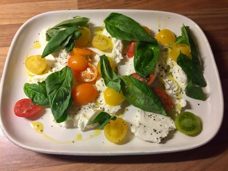 Served with a tomato, mozarella and basil salad