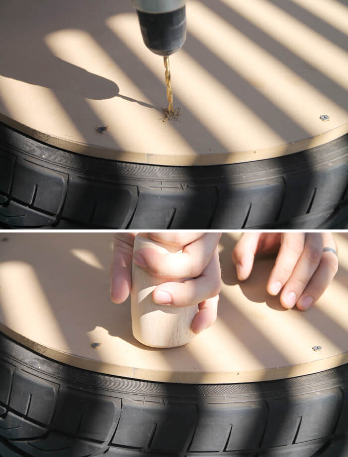 screwing furniture feet into plywood attached to tire for diy tire coffee table