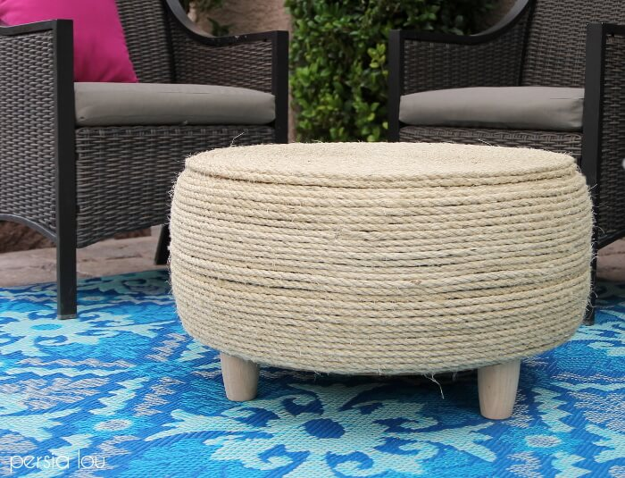 DIY Tire Coffee Table wrapped in rope on patio