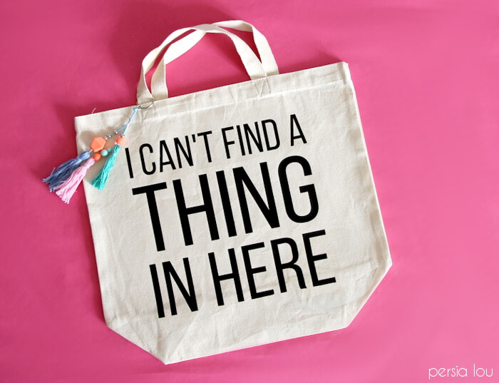 Super cute bag is super easy to make with heat transfer vinyl. Beaded tassels add a fun touch. (Plus dozens of other vinyl projects with Expressions Vinyl!)