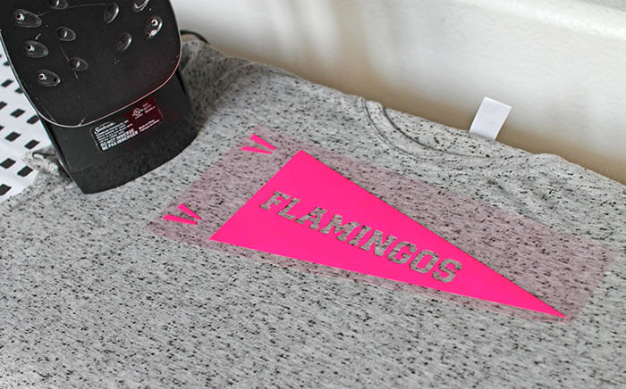 Make your own Neon Pennant Shirt for yarn, flamingos, or whatever you are enthusiastic about. Free Silhouette cut file and tutorial