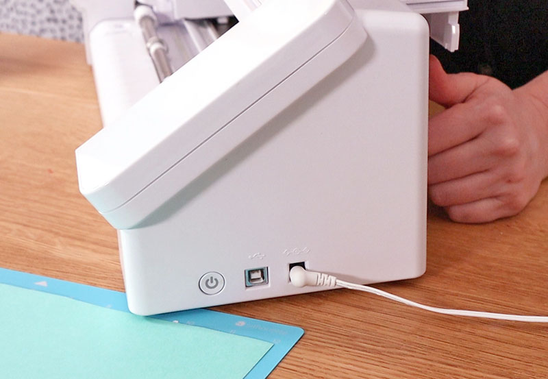 Power cord plugged into side of Silhouette Cameo 4.