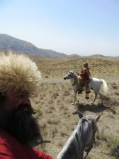 Katrina Kruse and Glen Percy riding in Persian outfits.