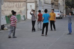 Children playing in an alley