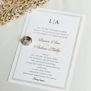 black thermography gold foil wedding invitation