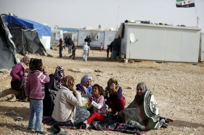 Syrian refugee women sit in front of their tents at the Al Zaatri refugee camp, in the Jordanian city of Mafraq, near the border with Syria, January 18, 2016. REUTERS/Muhammad Hamed