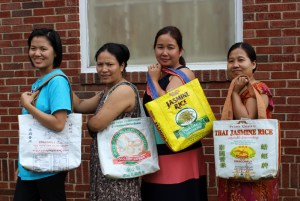 Refugee women in Charlotte, upcycling used rice bags into totes and purses.