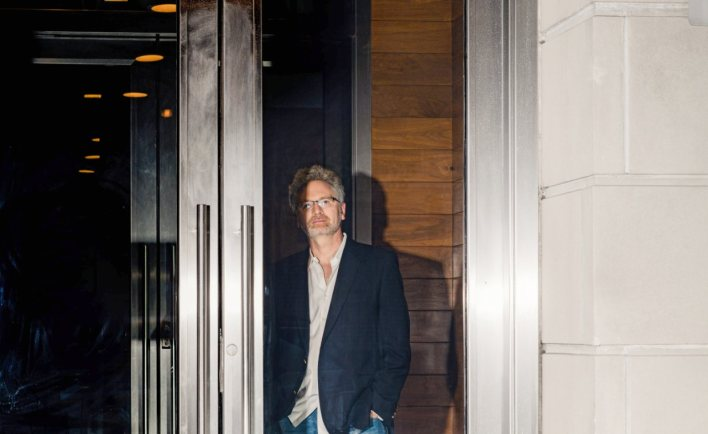 Adam Tooze behind the front door of his New York apartment building