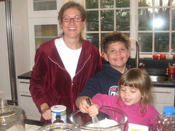 My cousin Nancy baking a chocolate cake with her kids DJ and Drew