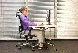 blog picture of man sitting at desk in ergonomic chair