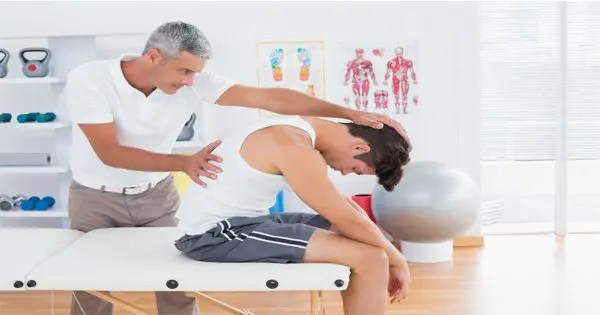 blog picture of chiropractor stretching a man's back