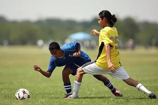 teenage boys play soccer