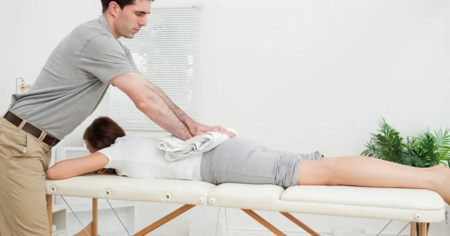 Image of a chiropractor performing spinal adjustments and manual manipulations for low back pain and sciatica.