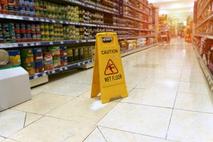 Wet floor sign at grocery store.