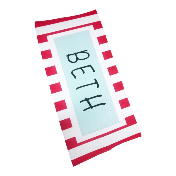 personalised beach towel in a coral pink stripe pattern with name