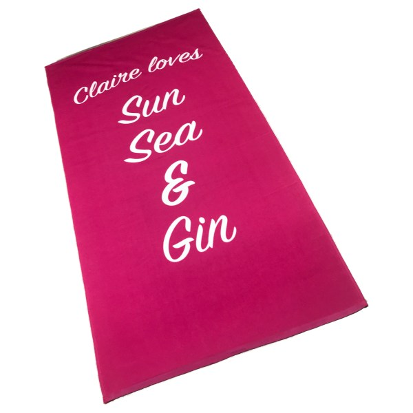 bright pink personalised beach towel printed with name and things you love