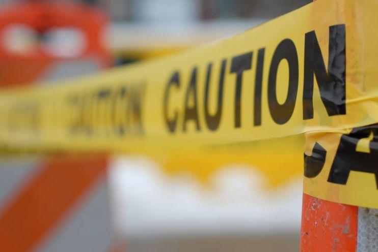 Caution tape around construction cones