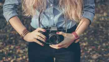 Girl with Camera Side Hustle personalprofitability.com