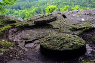 Switzerland: The millstone quarries in Mels (Canton St. Gallen), showing how rough outs were carved from the gritstone bedrock. This is a quarry with a history all the way back to the Roman period. Photo: Per Storemyr