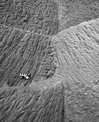 Pick (center) and chisel (top and bottom) tracks in the Ptolemaic part of the Shesmetet sandstone quarry near el-Kab. Smallest scale division is 1 cm. Photo by PER STOREMYR.