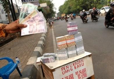 Hukum Tukar Menukar Uang