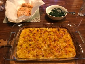 Keto cauliflower gratin shown with my dinner of salmon and spinach...yum!