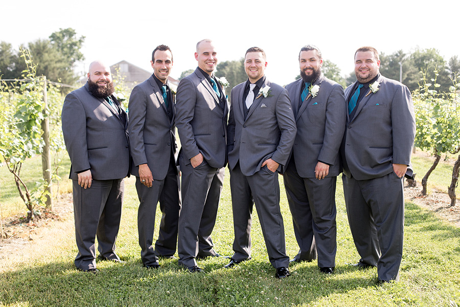 groom and his groomsmen in gray suits and black shirts