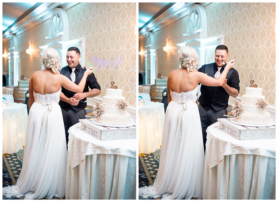 bride and groom share a slice of cake at the reception