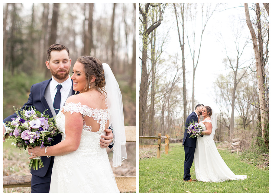 couple takes wedding portraits in field behind barn