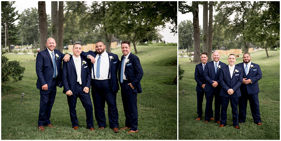 groom and groomsmen in navy suits with light blue accents