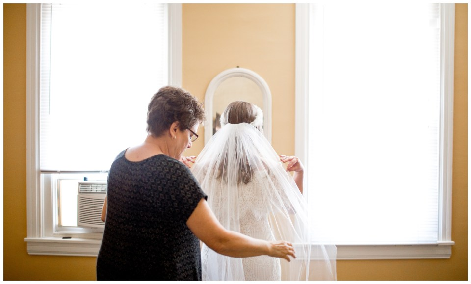 mother of the bride straightening the veil