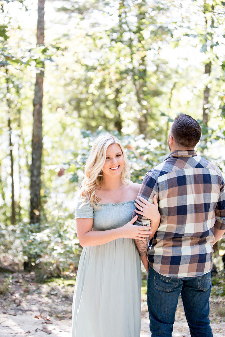 girl smiles at her fiance