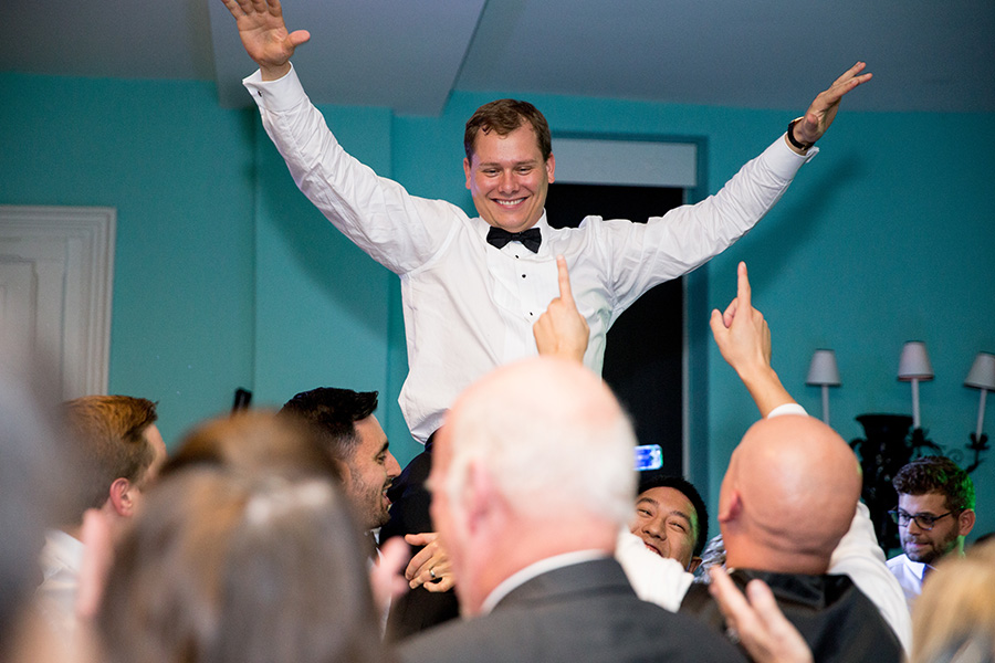 groom celebrating at congress hall wedding