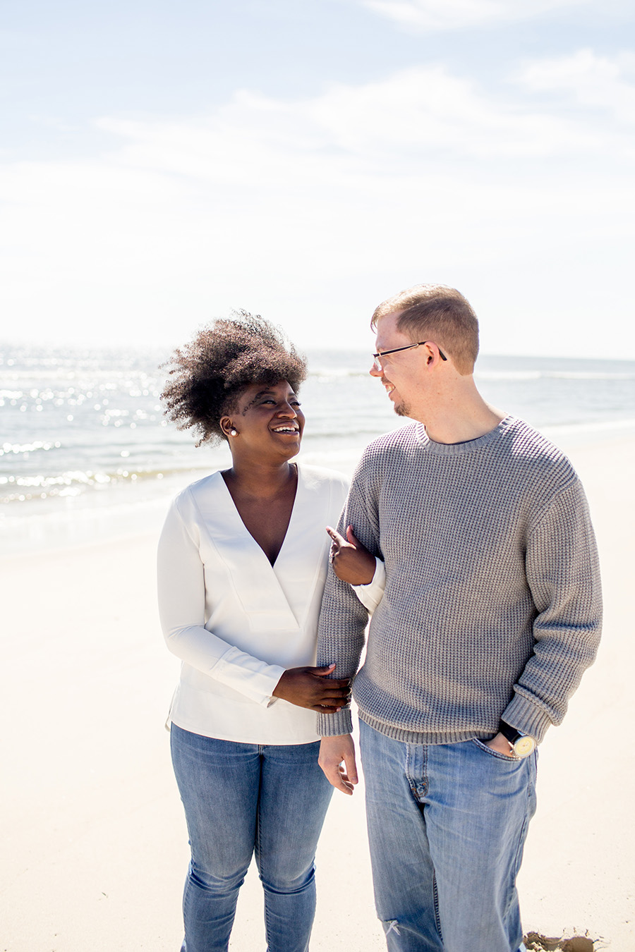 couple pose for a portrait on the beach in LBI