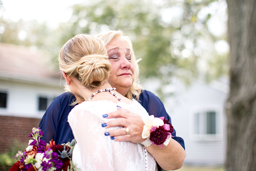 bride does an emotional first look with her mom