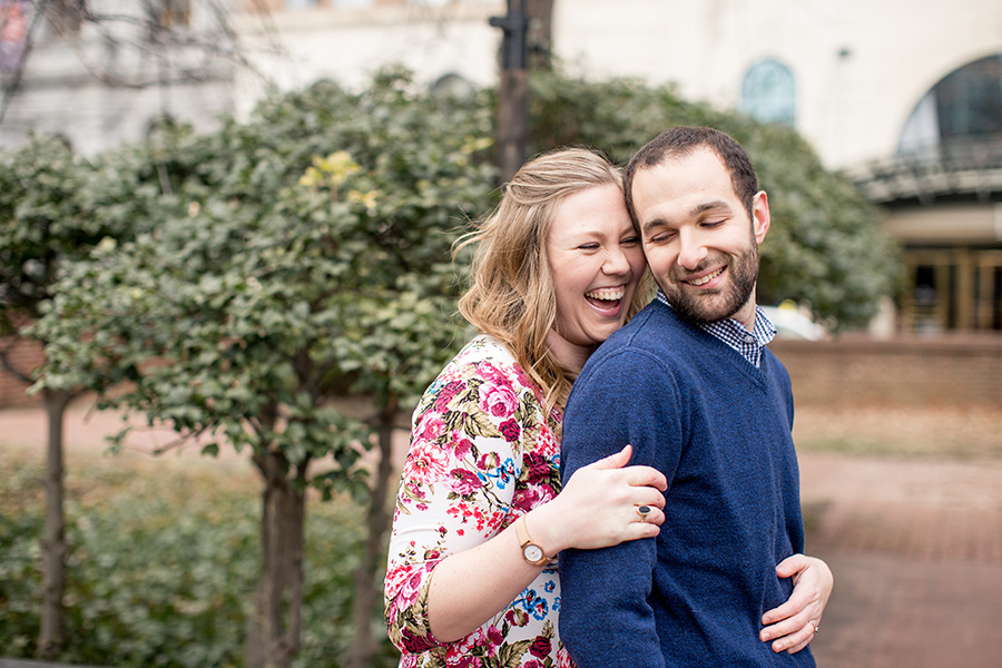 couple laughs together at their historic philadelphia engagement session