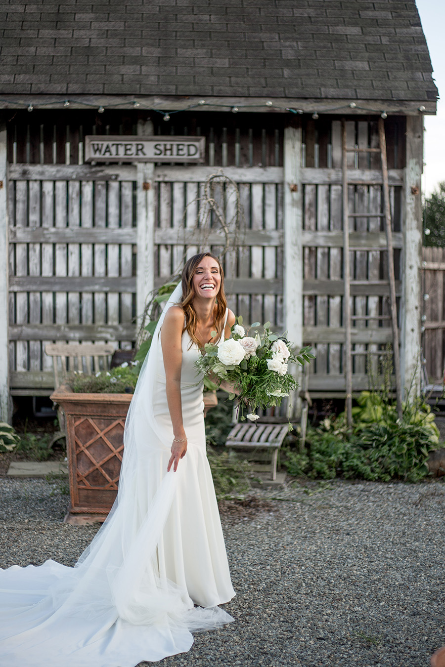 bride poses at bast brothers wedding venue
