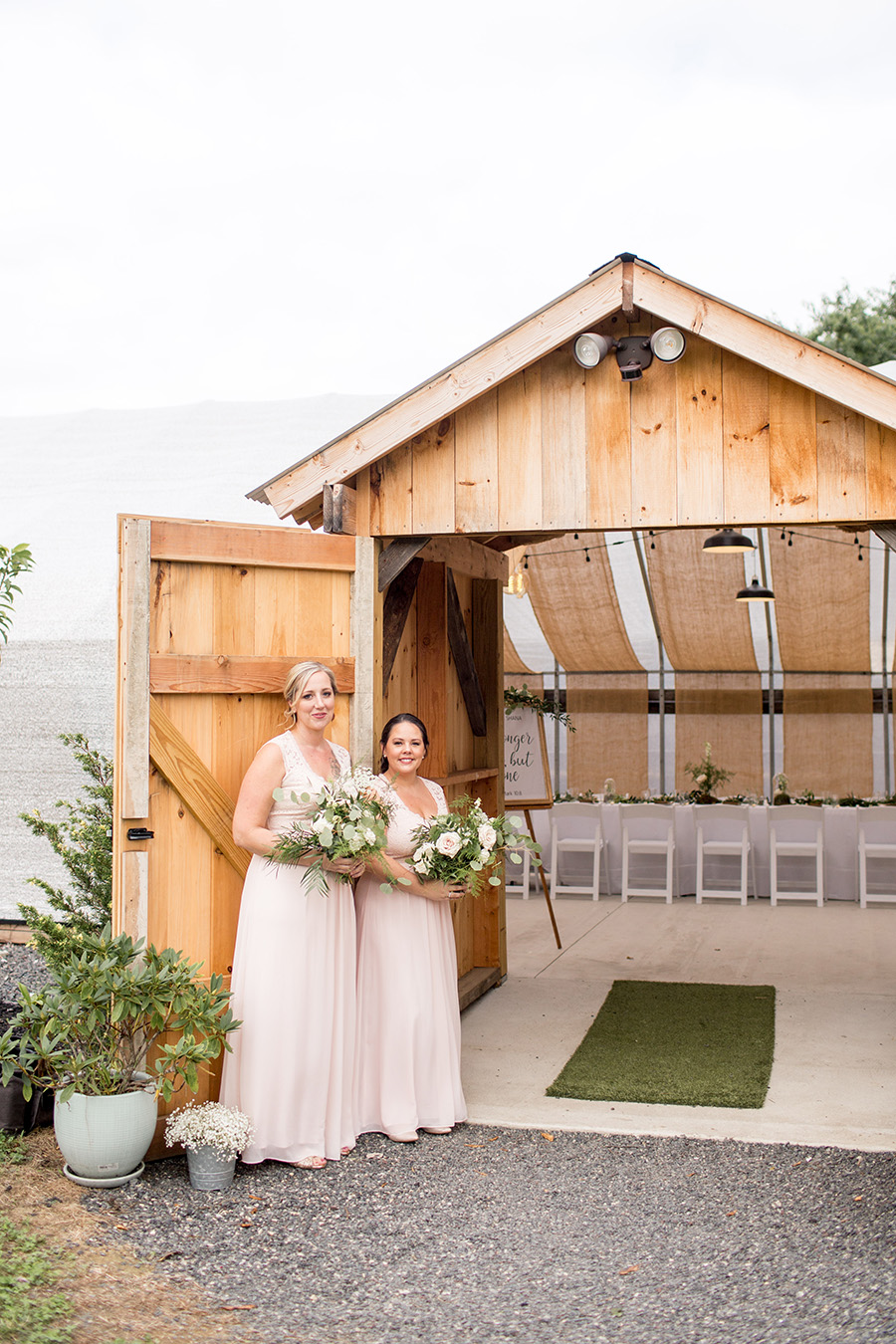 bridesmaids welcome wedding guests into the greenhouse