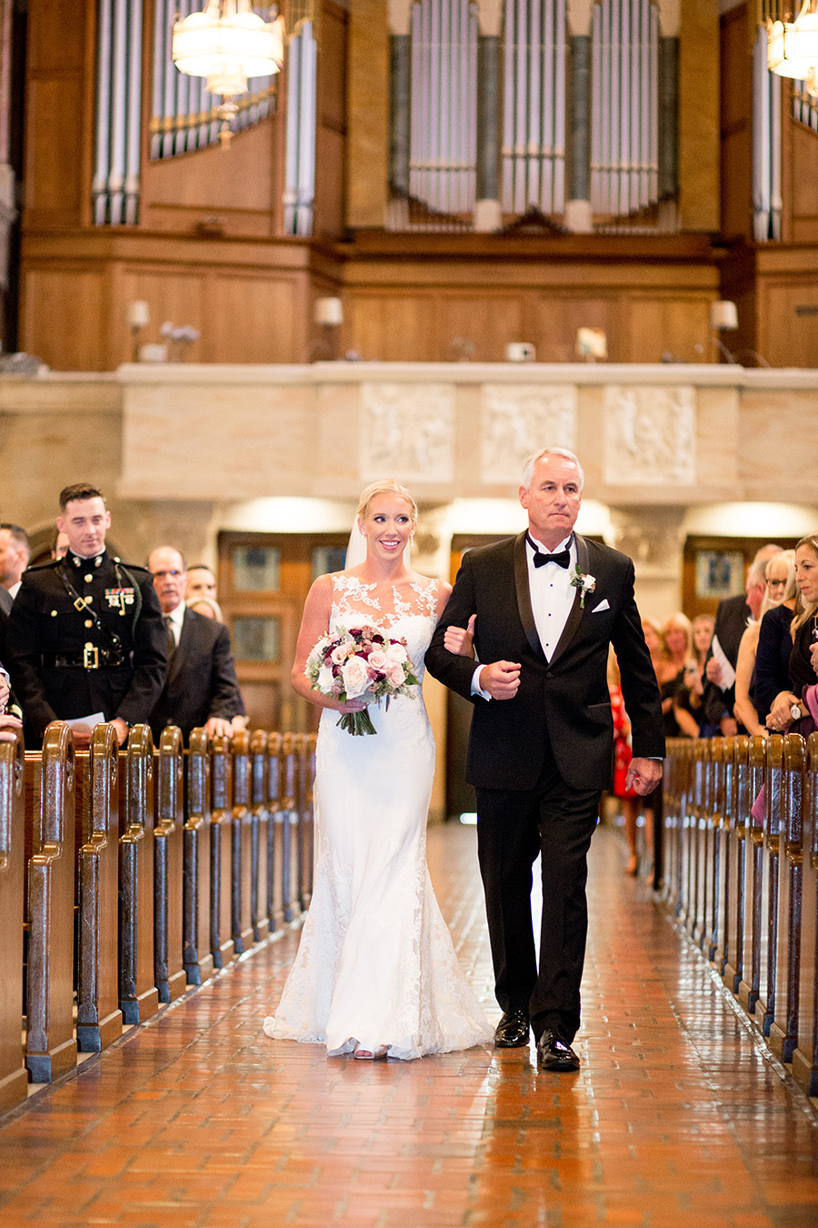 bride walks down the aisle during wedding ceremony at st anthony of padua in wilmington