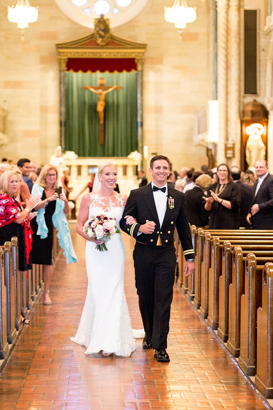 bride and groom walk down the aisle together at st anthony of padua church in wilmington