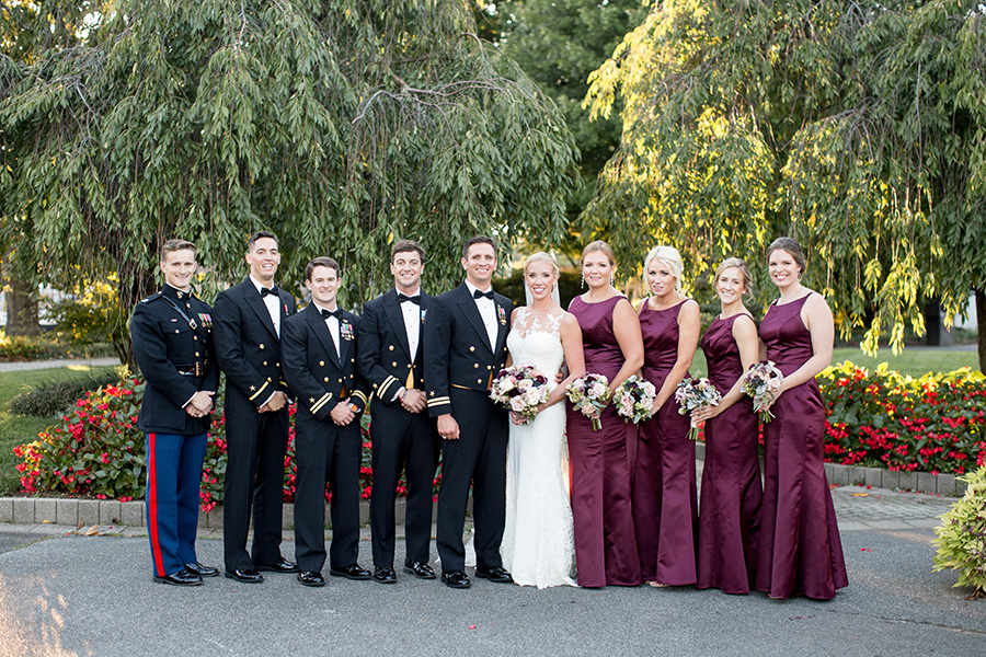 bridemaids and groomsmen stand with the couple at dupont country club wedding in wilmington