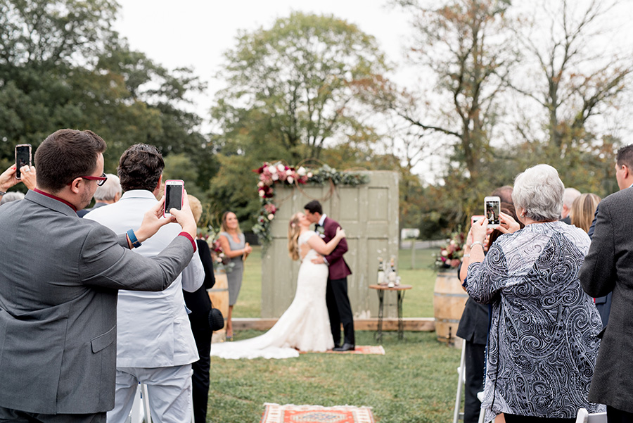 guests cheer on the newly married couple at the alpaca farm