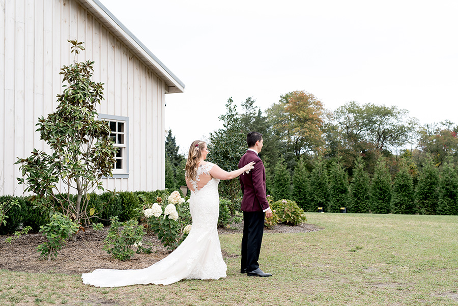 bride and groom share their first look at alpaca farm