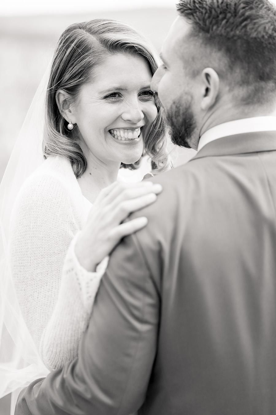 bride smiling at her groom