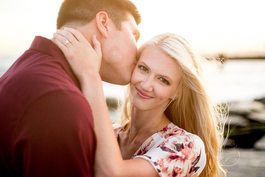 couple share a kiss on the beach