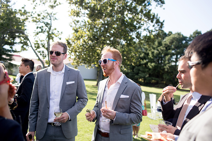 groomsmen have fun together on the lawn
