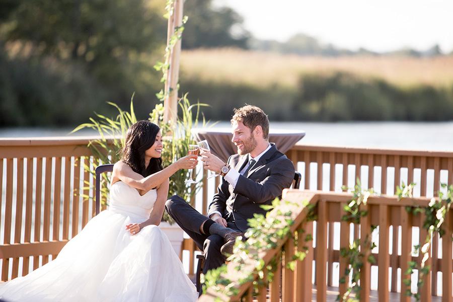 bride and groom enjoy a toast